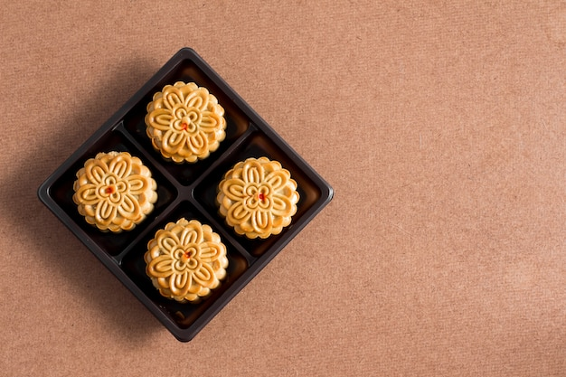Moon cake on wood background