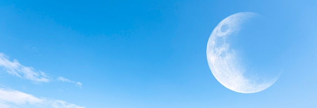 Moon and clear blue sky as background, panoramic view