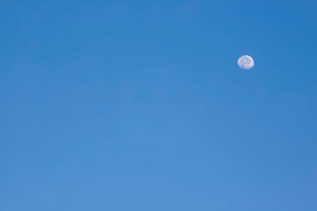 Moon. half moon shrouded in brightness on blue background