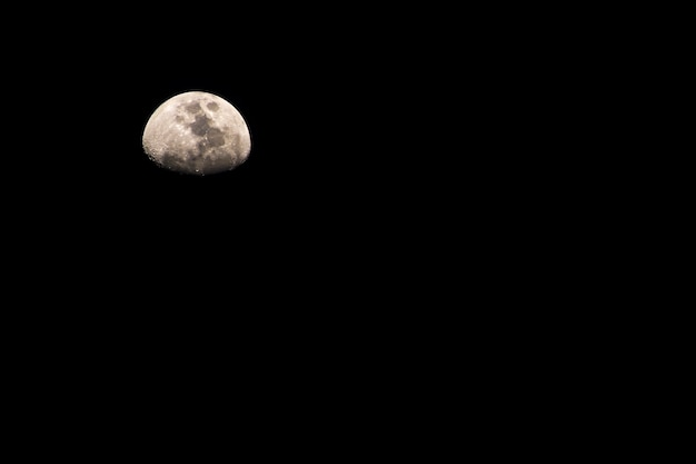 Moon. half moon shrouded in darkness background