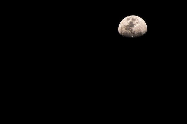 Moon. half moon shrouded in darkness