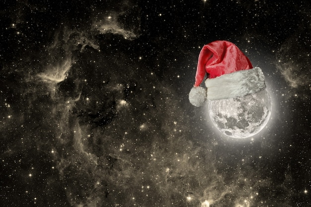 The moon is wearing a hat for christmas