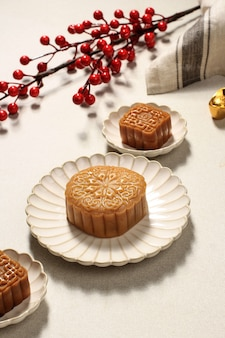 Mooncake on light background with tea. concept moon cake on mid autumn festival or chinese new year (imlek). mooncake popular as kue bulan.
