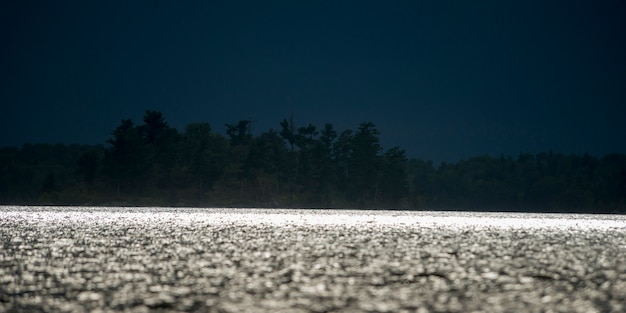 Moonlight reflecting off the lake, lake of the woods, ontario, canada