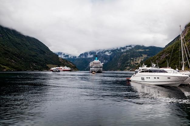 Moored boats and cruise moored on idyllic lake