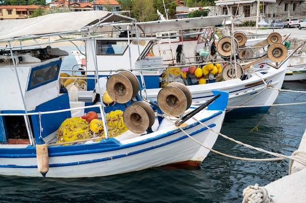 Moored boats with lots of fishing accessories in the sea port, aegean sea in ormos panagias, greece