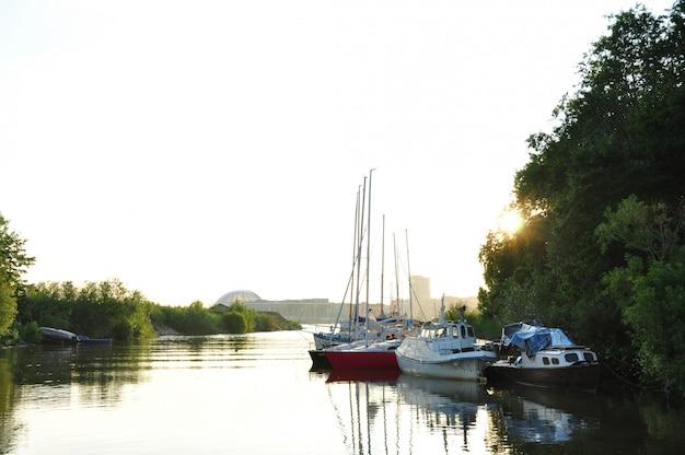 Moored yachts at sunset.