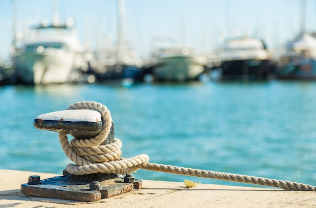 Mooring rope on sea water background