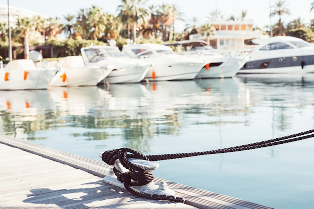 Mooring yacht rope tied around a cleat