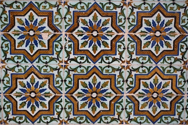 Moorish ceramic tiles in the walls of a palace. sevilla, andalusia, spain.
