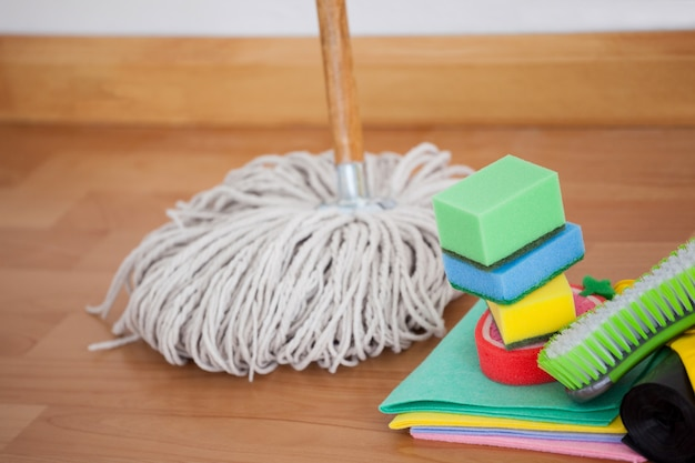 Mop and cleaning equipment on wooden floor