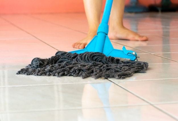 Mop the floor of clean the house