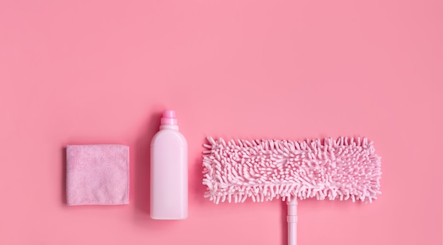 Mop, rag and detergent-pink set for spring cleaning.