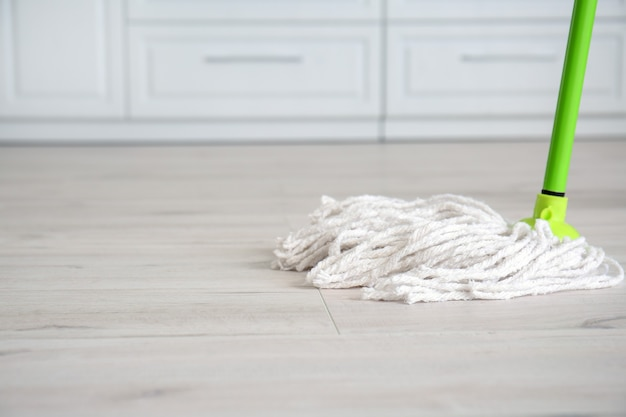 Mopping of floor in kitchen