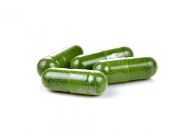 Moringa capsule pills on white background