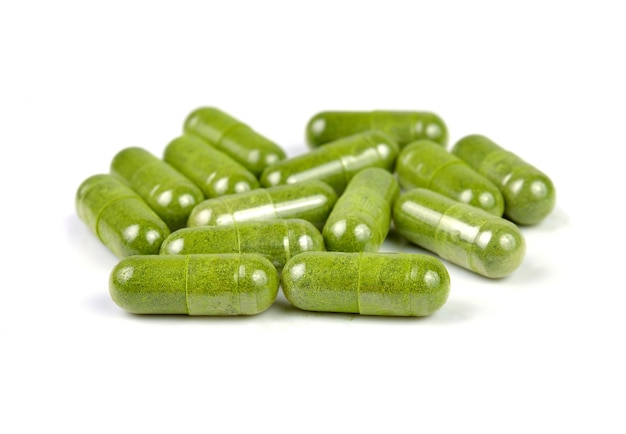 Moringa capsule pills on white background