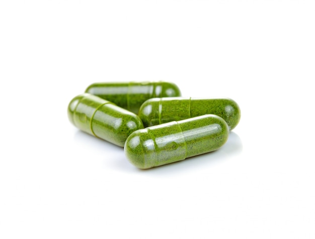 Moringa capsule pills on white