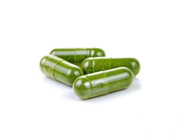 Moringa capsule pills on white