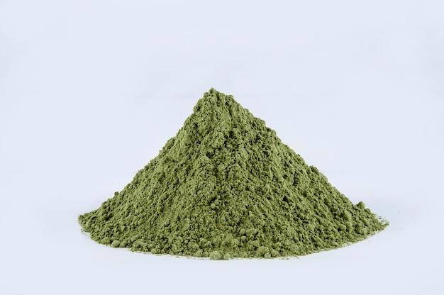 Moringa powder on white background