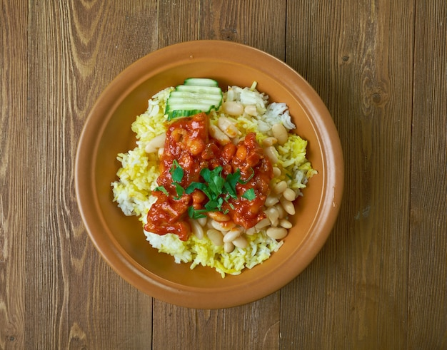 Morisqueta dish meal from southern and western mexico, consists of cooked rice, combined with beans, and served with a sauce of tomato, onion and garlic, other sauces with pork or beef