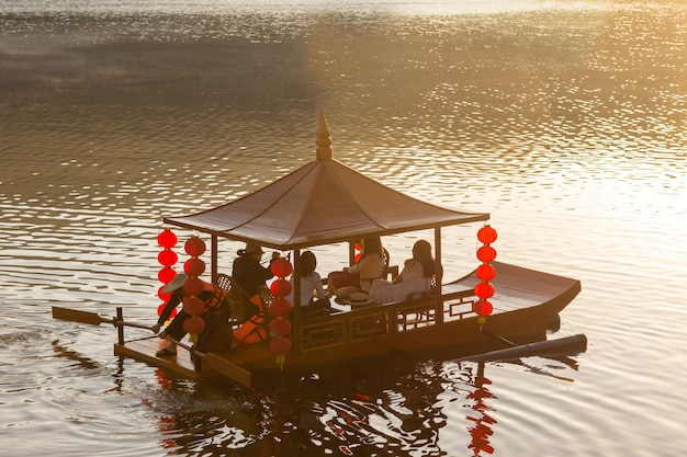 Morning atmosphere at rak thai village with a small boat waiting service for tourists