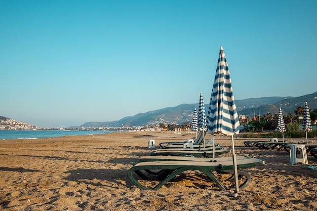 Morning beach, lounge chairs for recreation, sea. concept vacation, rest, walking on the ship.