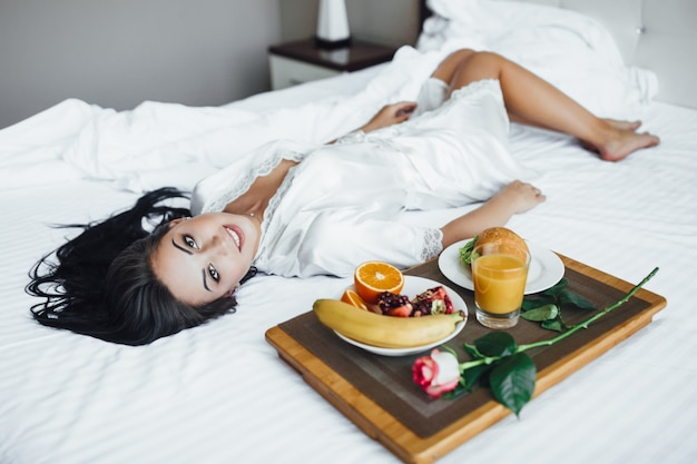 Morning of a beautiful girl with rose and food