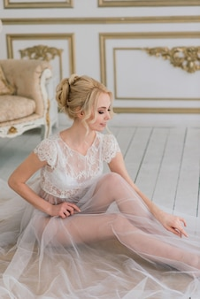 Morning of a beautiful young bride in a boudoir dress. , interior.