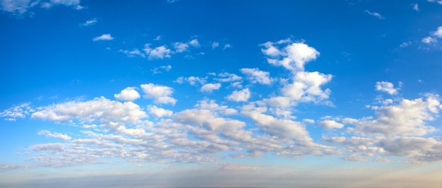Morning blue sky panorama with cumulus clouds