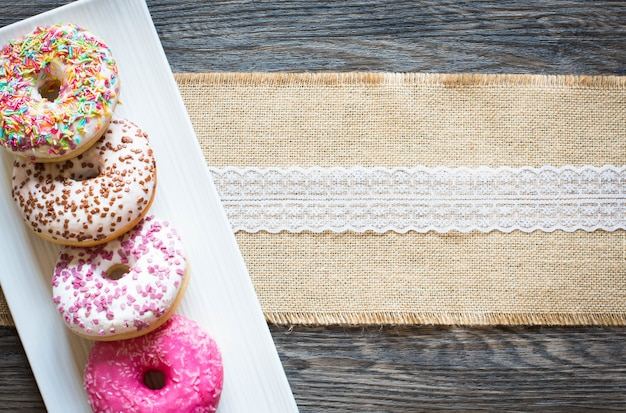 Morning breakfast with colorful donuts