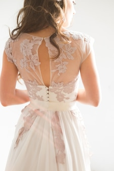 Morning of the bride. the bride is standing back, beautiful curlswhite background