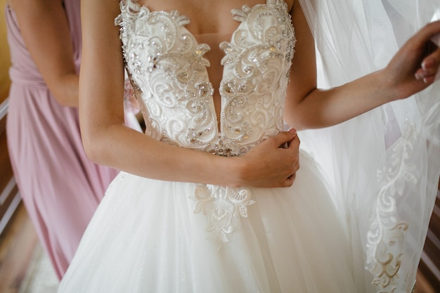 Morning of the bride when she wears a beautiful dress