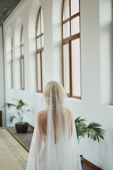 Morning of the bride, when she wears a beautiful peignoir, woman prepares before the wedding