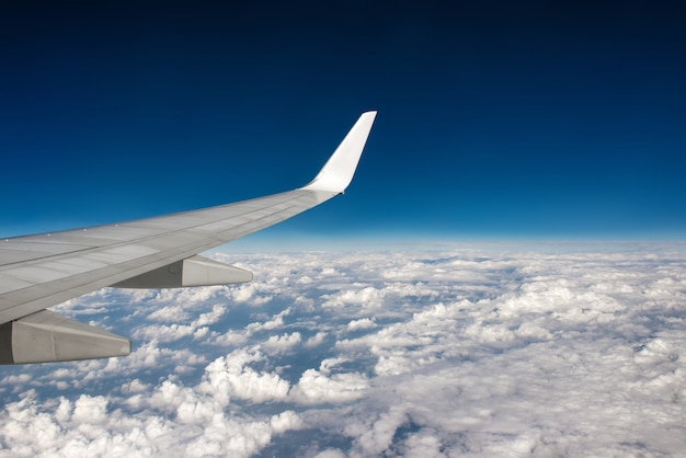 Morning cloudy sunrise with wing of an airplane. picture for add text message or frame website. traveling concept