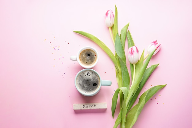 Morning coffee, spring tulip flowers. women's day on march 8th concept. flat lay.