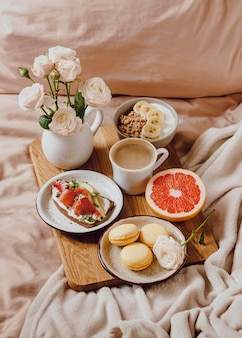 Morning coffee on tray with sandwich and grapefruit