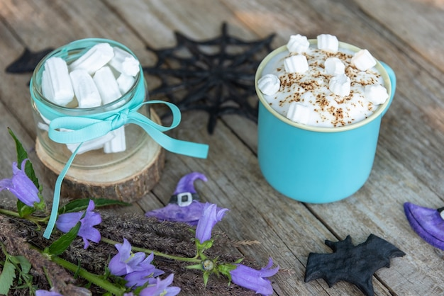 Morning coffee with marshmallow slices. the day of halloween.