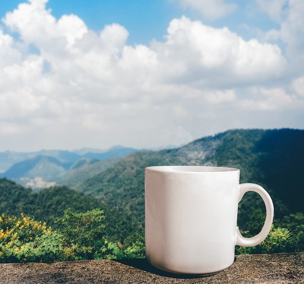 Morning cup of coffee with mountain view.