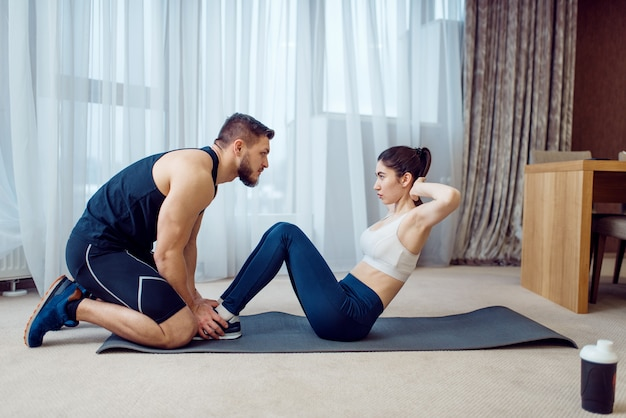 Morning fit training of couple at home