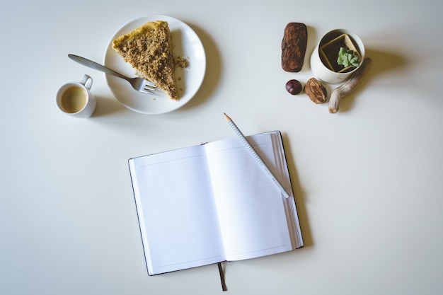 Morning journaling with cake and coffee