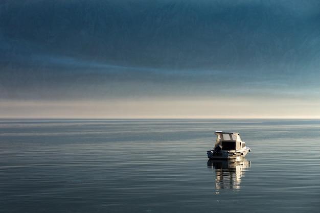 Morning in kotor bay. boat on the kotor bay. montenegro.