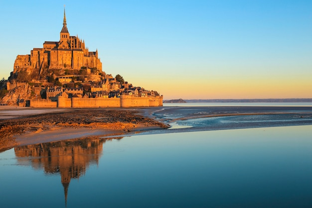 Morning light on mont saint michel in normandy, france