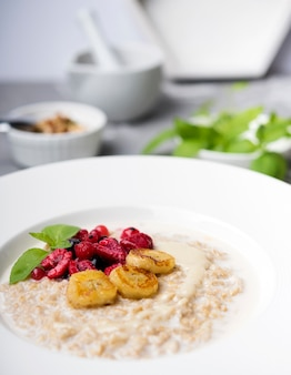 Morning meal with crushed cereals close-up