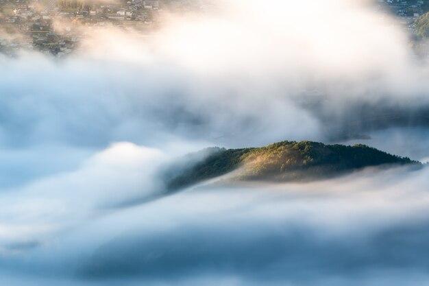 Morning mist over kawaguchi lake closed to fuji mountain