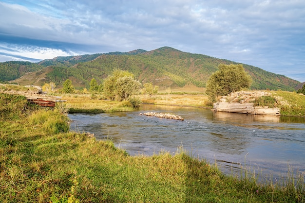 Morning mountain landscape with a river. autumn in the karakol river valley, altai mountains, russia