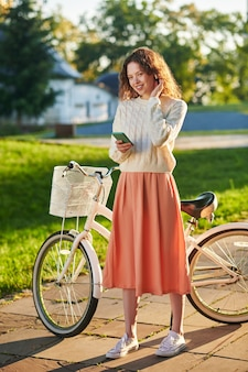 Morning in a park. a picture of a girl with a bike in a park