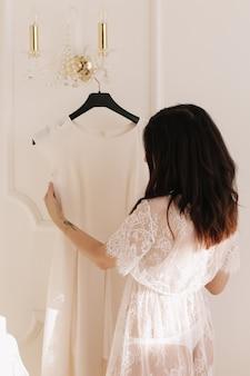 Morning preparations of a bride wearing wedding dress