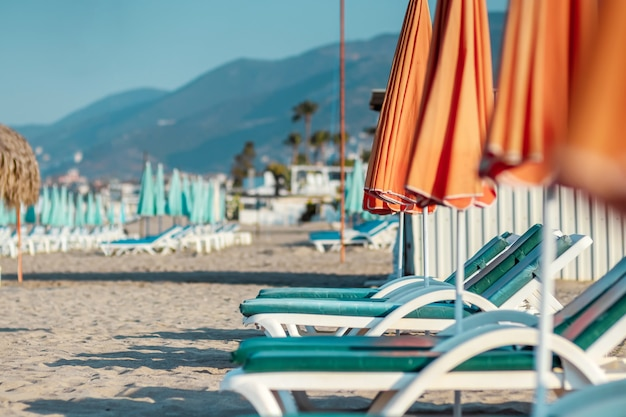 Morning sea, beach, empty sun beds for vacationers. concept of travel, rest, relax.