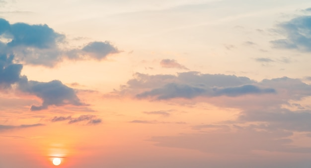 Morning sky background with colorful orange sunrise and clouds fluffy