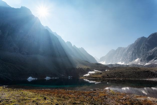 The morning sun illuminates the mountain valley